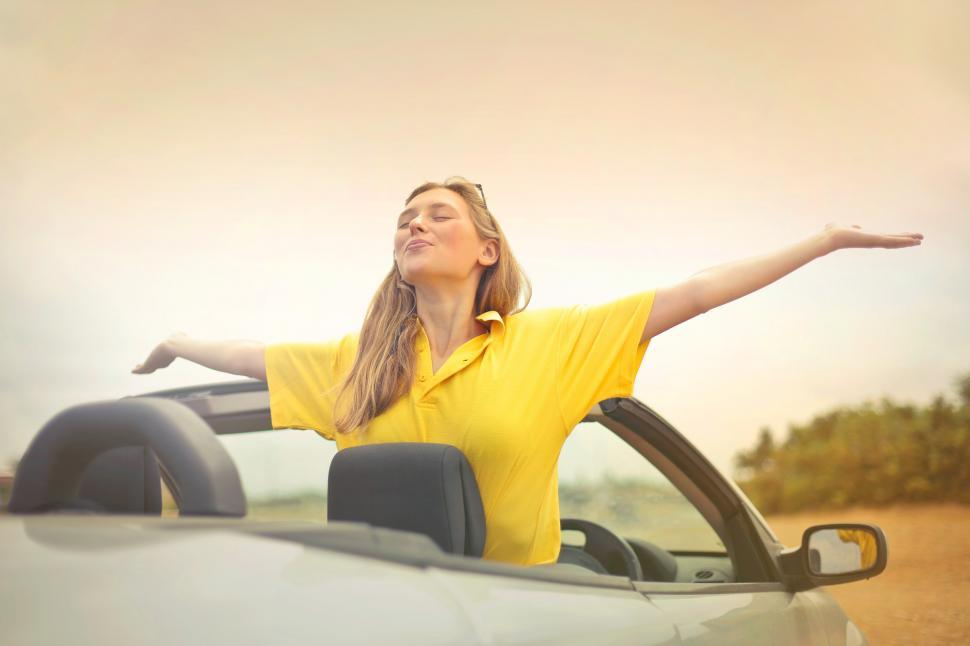 Download Free Stock Photo of Young Woman In Yellow Shirt Enjoying Weather With Open Arms
