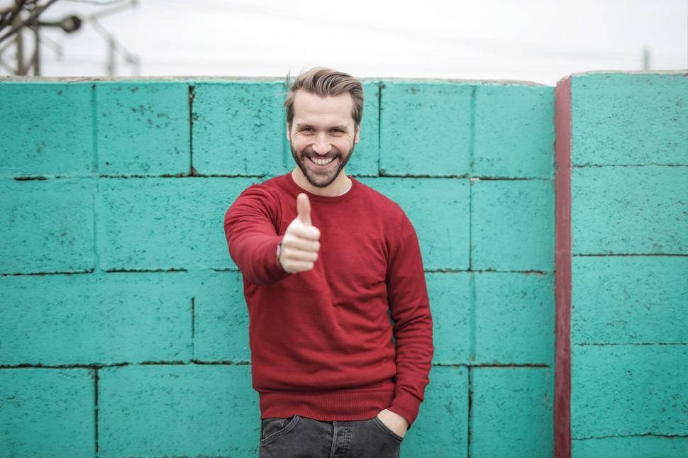 Download Free Stock HD Photo of Young Adult Man showing thumbs up gesture Online
