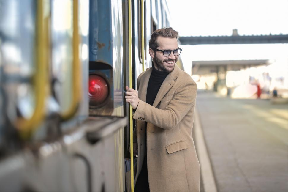 Download Free Stock HD Photo of Young Adult Man About to Enter the Train Online