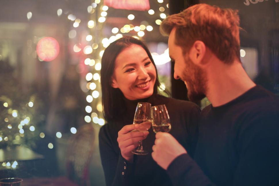 Download Free Stock HD Photo of Young couple raising toast with glasses of wine Online