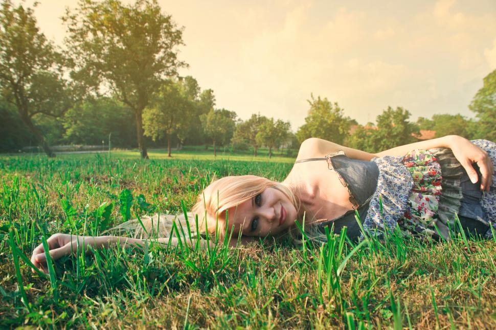 Download Free Stock Photo of Young Happy Woman Relaxing On Green Grass