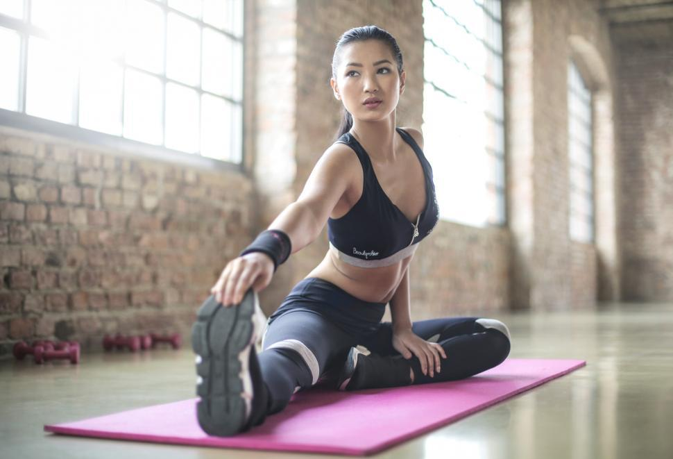 Download Free Stock Photo of Woman in Black Sports Bra and Black Leggings Doing Yoga