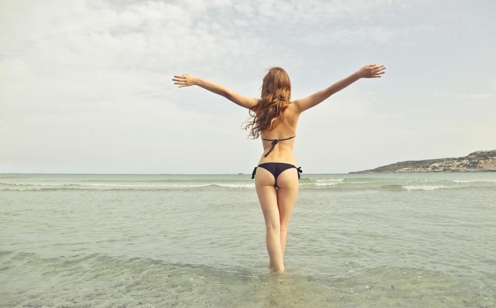 Download Free Stock HD Photo of Woman Wearing Black Bikini Standing With Open Arms Online