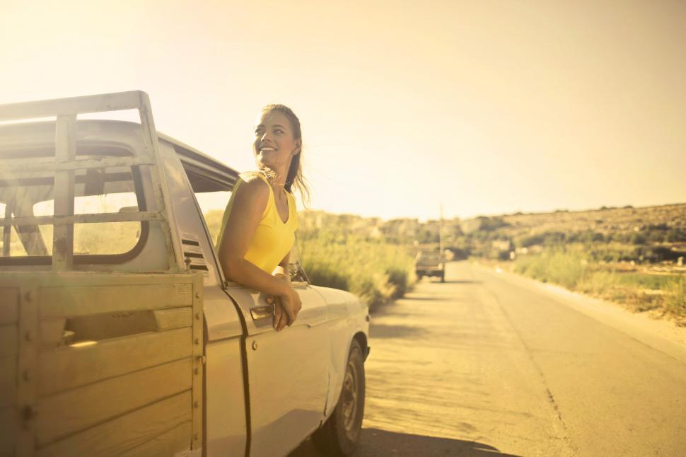 Download Free Stock Photo of Young Beautiful Woman in Yellow Polo Shirt standing inside drive
