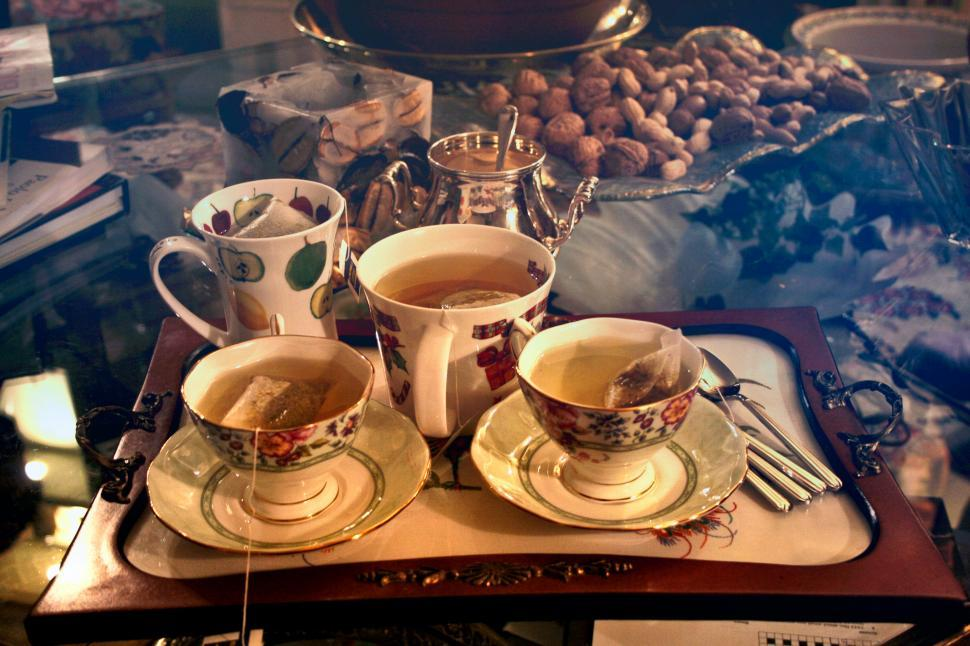 Download Free Stock HD Photo of Three Cups Of Tea On Serving Tray Online