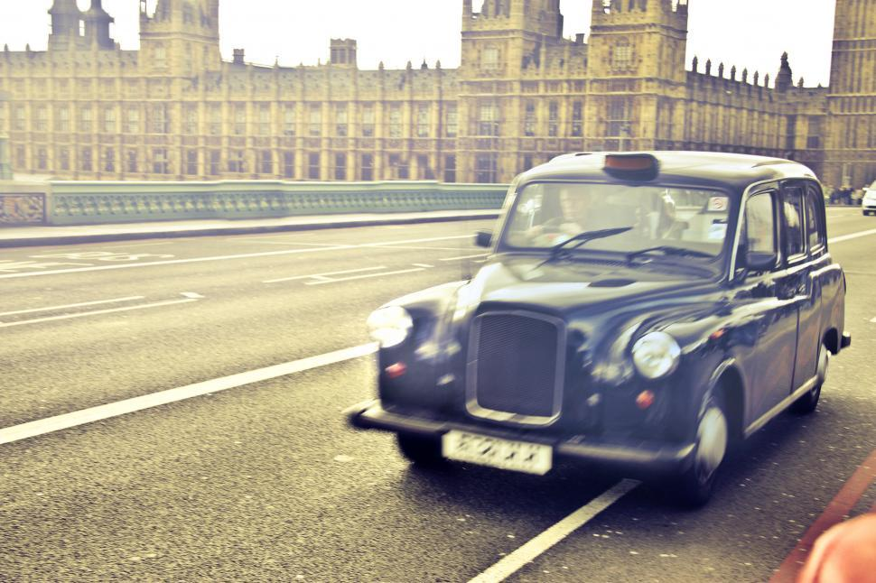 Download Free Stock Photo of Blue Taxi cab in motion, London
