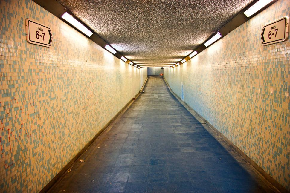 Download Free Stock HD Photo of Illuminated Empty Underground Walkway Online