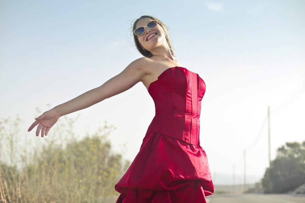 Download Free Stock HD Photo of Young Adult Woman In Red Party Gown Dress And Sunglasses During Online