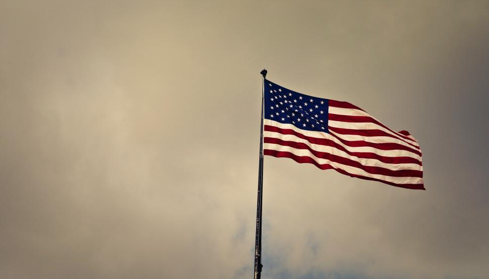 Download Free Stock Photo of American flag fluttering in an overcast weather