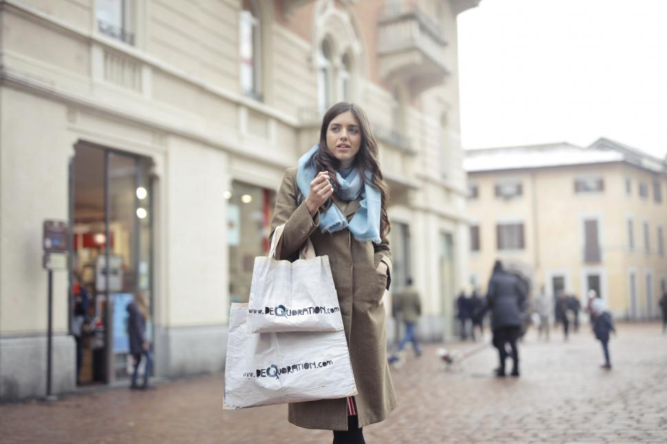 Download Free Stock Photo of A young woman with shopping bags