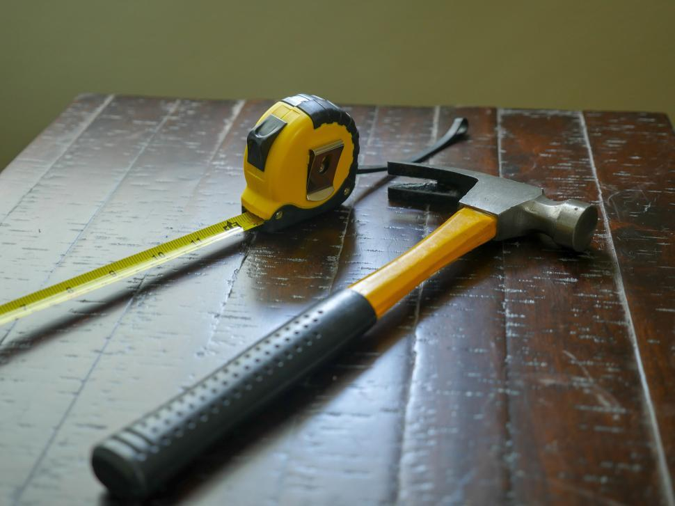 Download Free Stock HD Photo of Hammer and measuring tape Online