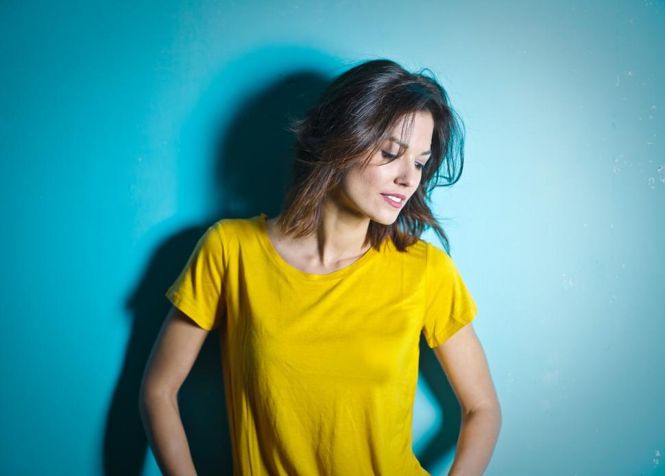 Download Free Stock HD Photo of Young Woman In Yellow Scoop Neck T-Shirt Posing During Photo-sho Online