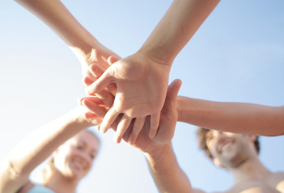 Download Free Stock Photo of A group of people in a huddle outdoors