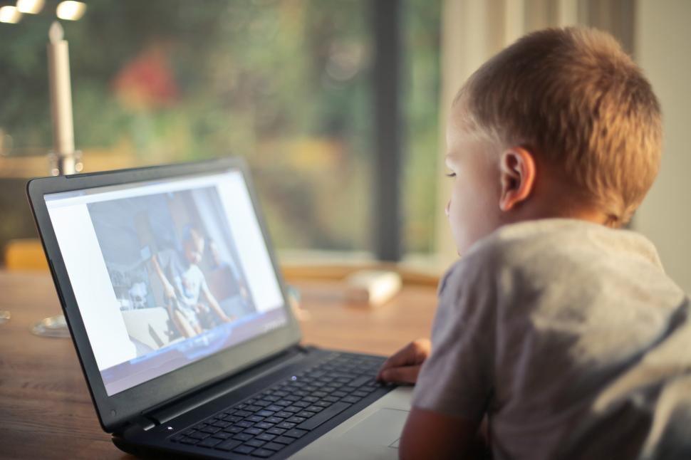 Download Free Stock HD Photo of A young caucasian child watching movie on laptop Online