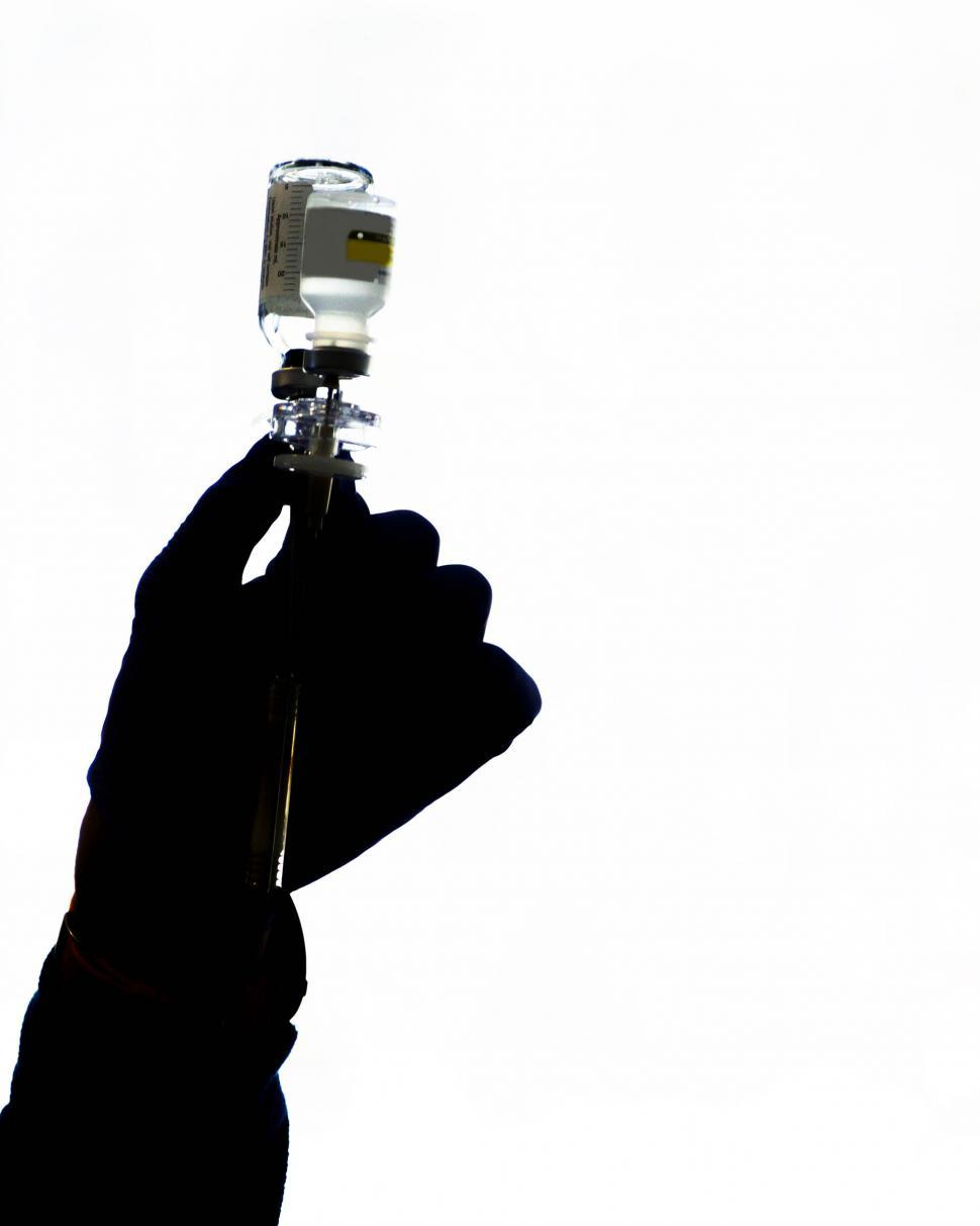 Download Free Stock Photo of Silhouette of hand with medical solution