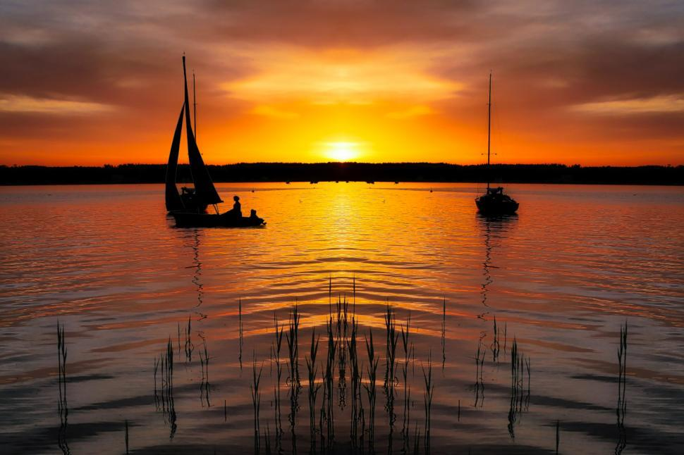 Download Free Stock Photo of boat on lake at sunset