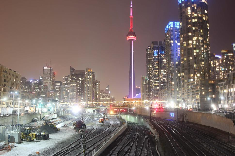Download Free Stock Photo of Train Tracks at night with CN Tower in the background