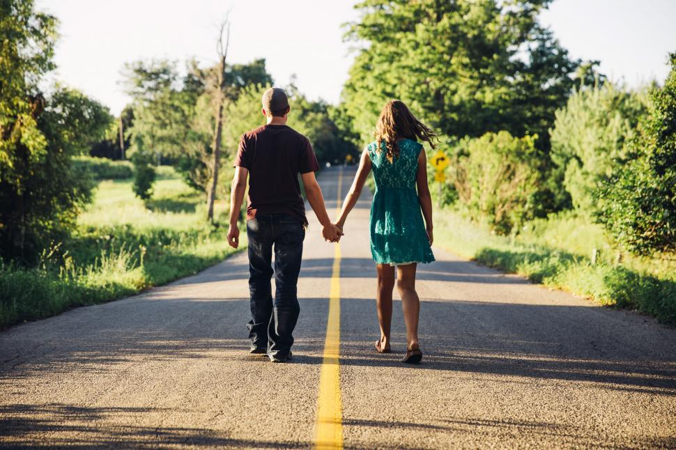 Download Free Stock HD Photo of A young caucasian couple holding each other s hands Online