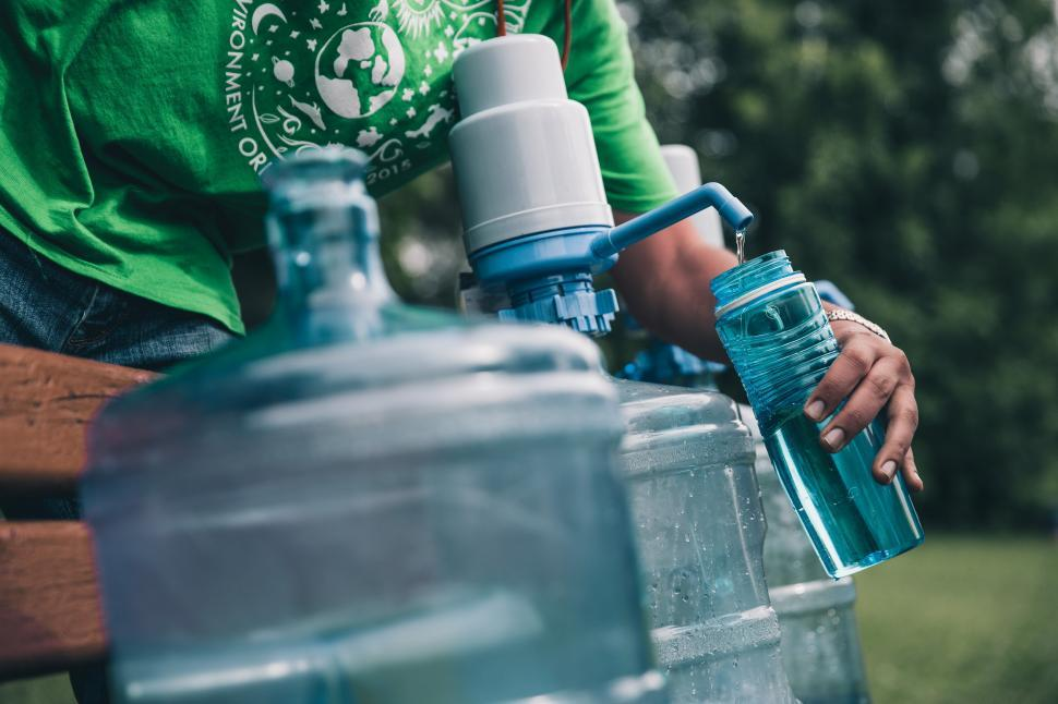 Download Free Stock HD Photo of Filling water water from a can Online