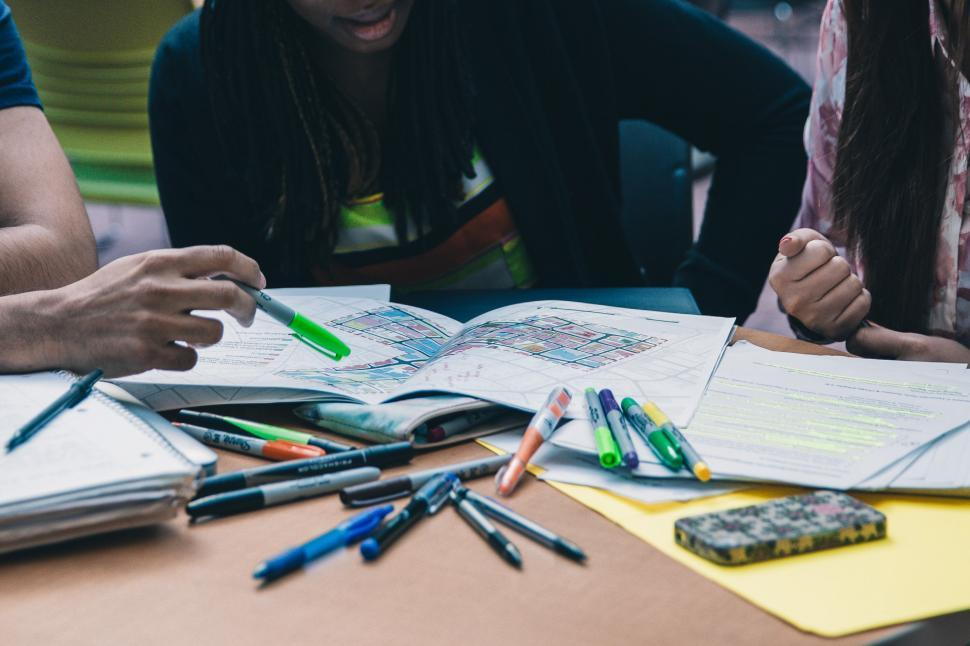 Download Free Stock HD Photo of A group of multiethnic students working on project Online
