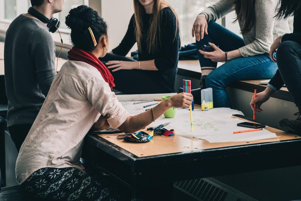 Download Free Stock Photo of A group of multiethnic students working on project