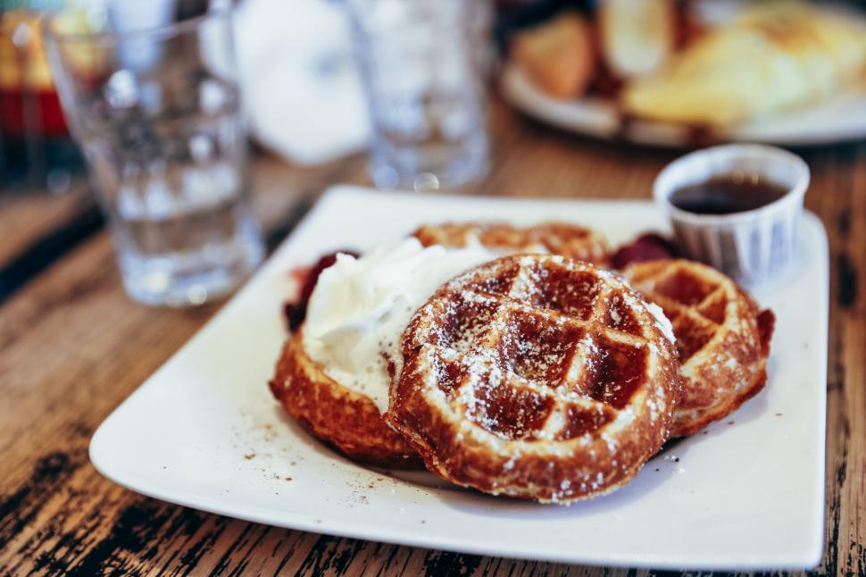 Download Free Stock HD Photo of Close-up of waffles and whipped cream Online