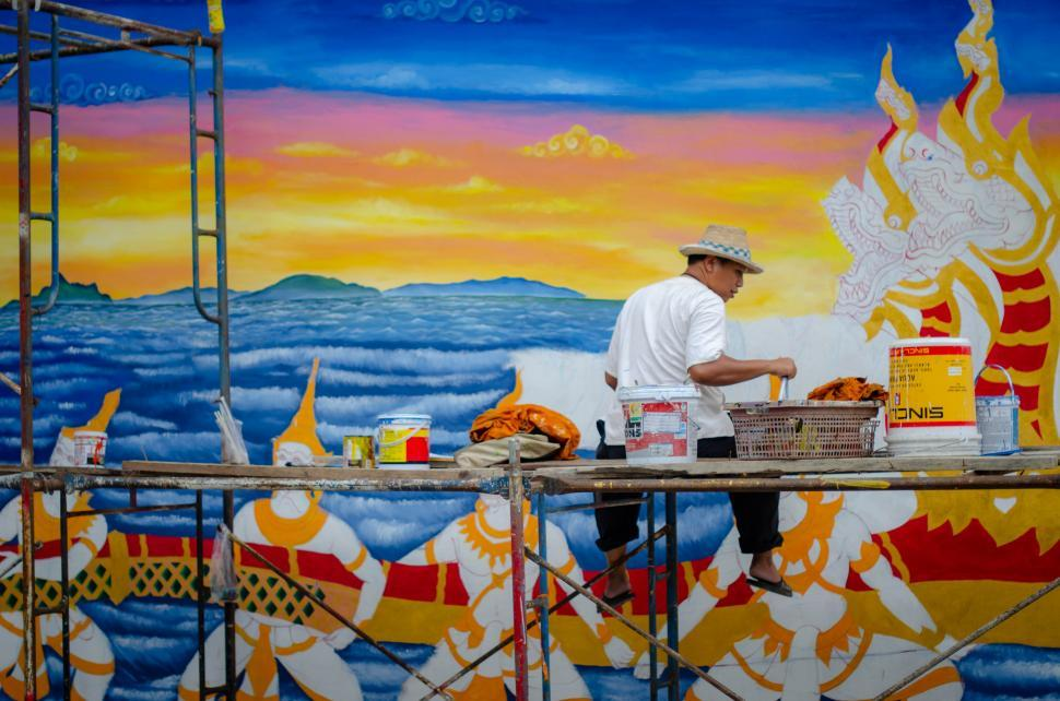 Download Free Stock Photo of Muralist Painting Wall