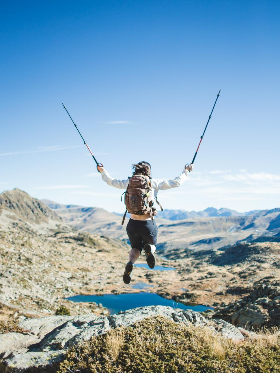 Download Free Stock Photo of A hiker jumps in joy