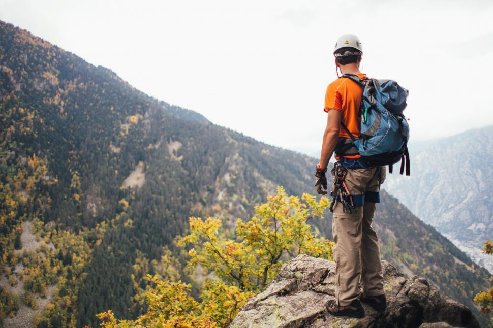 Download Free Stock Photo of A young climber standing on a rock
