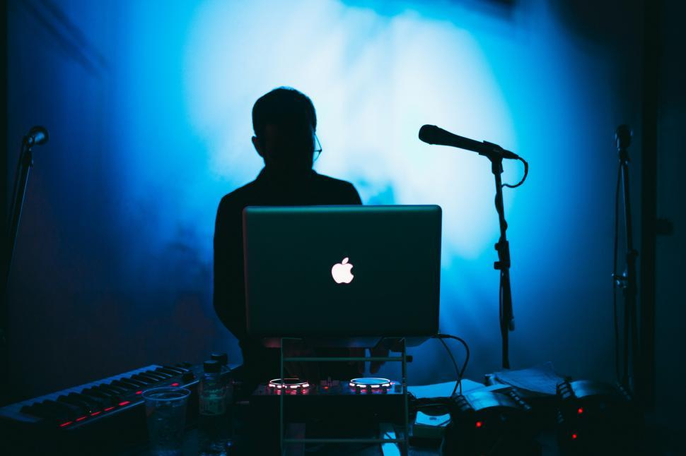 Download Free Stock HD Photo of A DJ in blue light Online