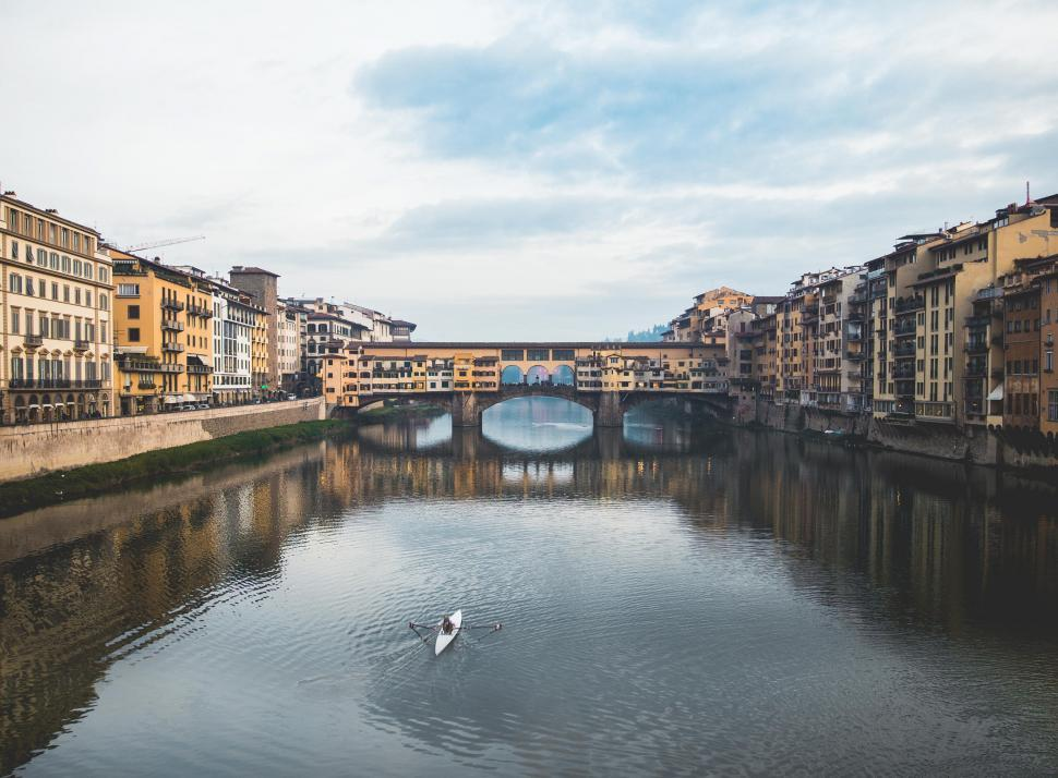 Download Free Stock HD Photo of Ponte Vecchio bridge over the Arno River in Florence, Italy Online