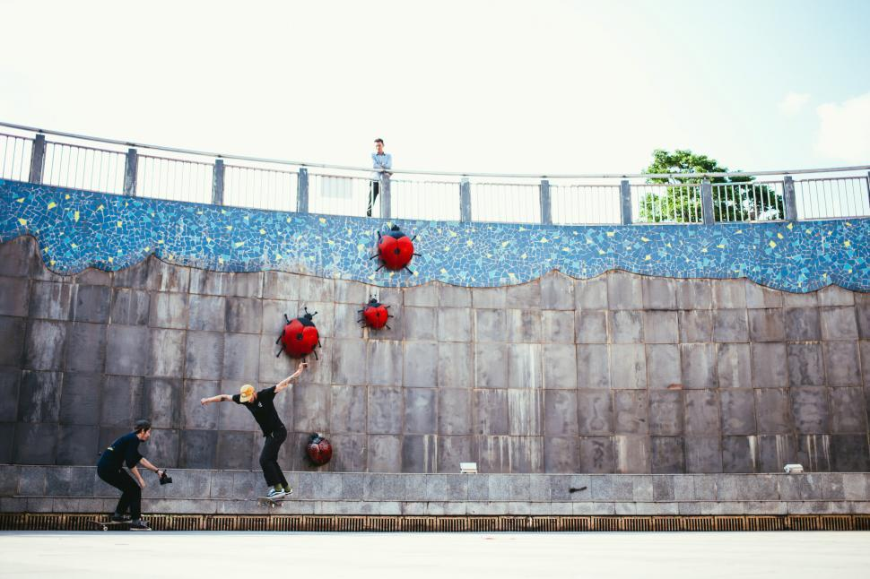 Download Free Stock HD Photo of An onlooker watching one skateboarder photographed by another Online