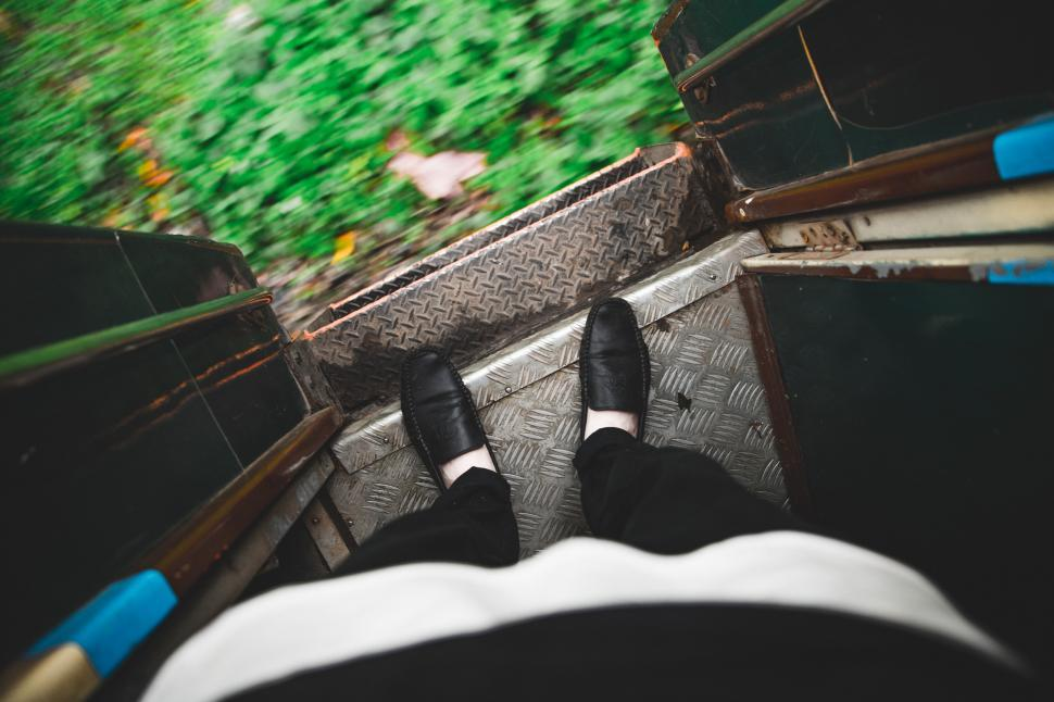 Download Free Stock Photo of Feet on the edge of entrance door of a running train in Myanmar