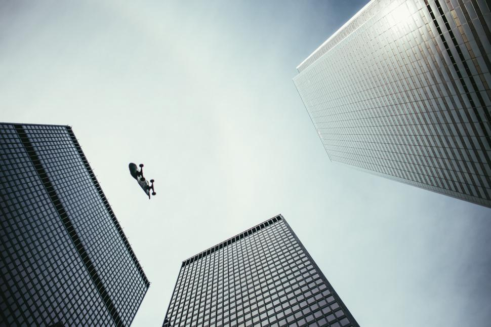 Download Free Stock Photo of Perspective view of skateboard in the air