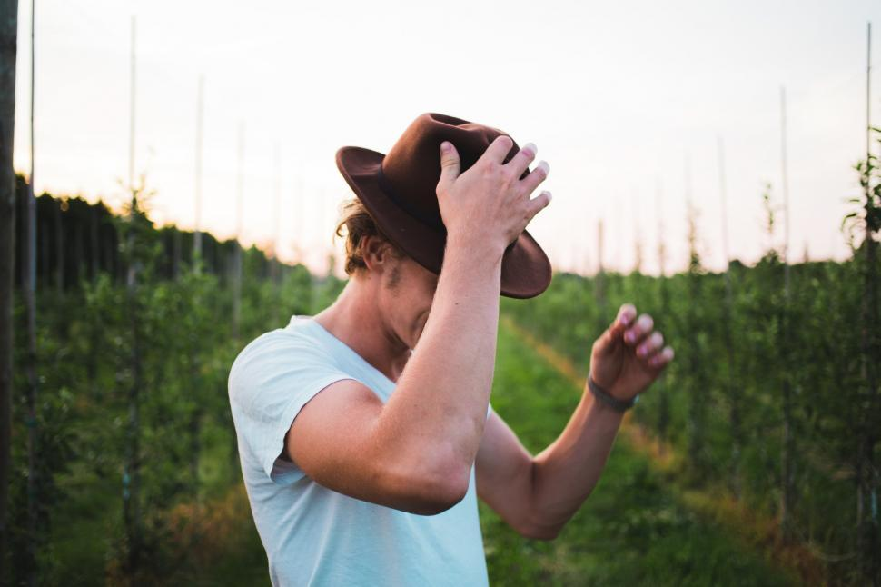 Download Free Stock Photo of A young Caucasian man posing in a vineyard