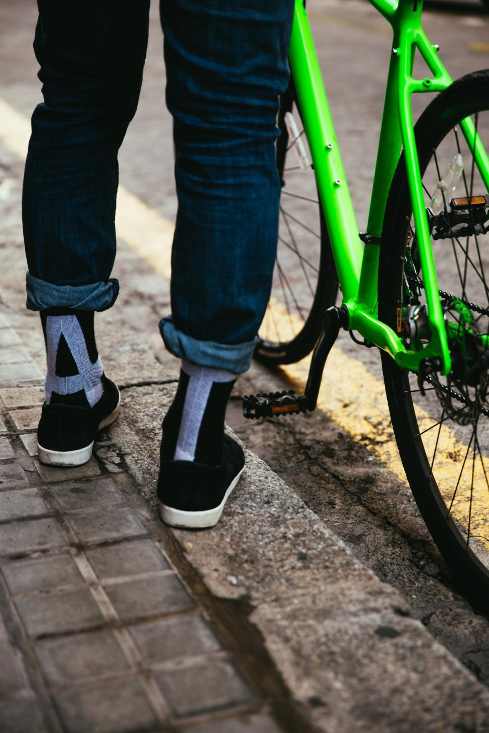 Download Free Stock Photo of A biker s feet with green bicycle