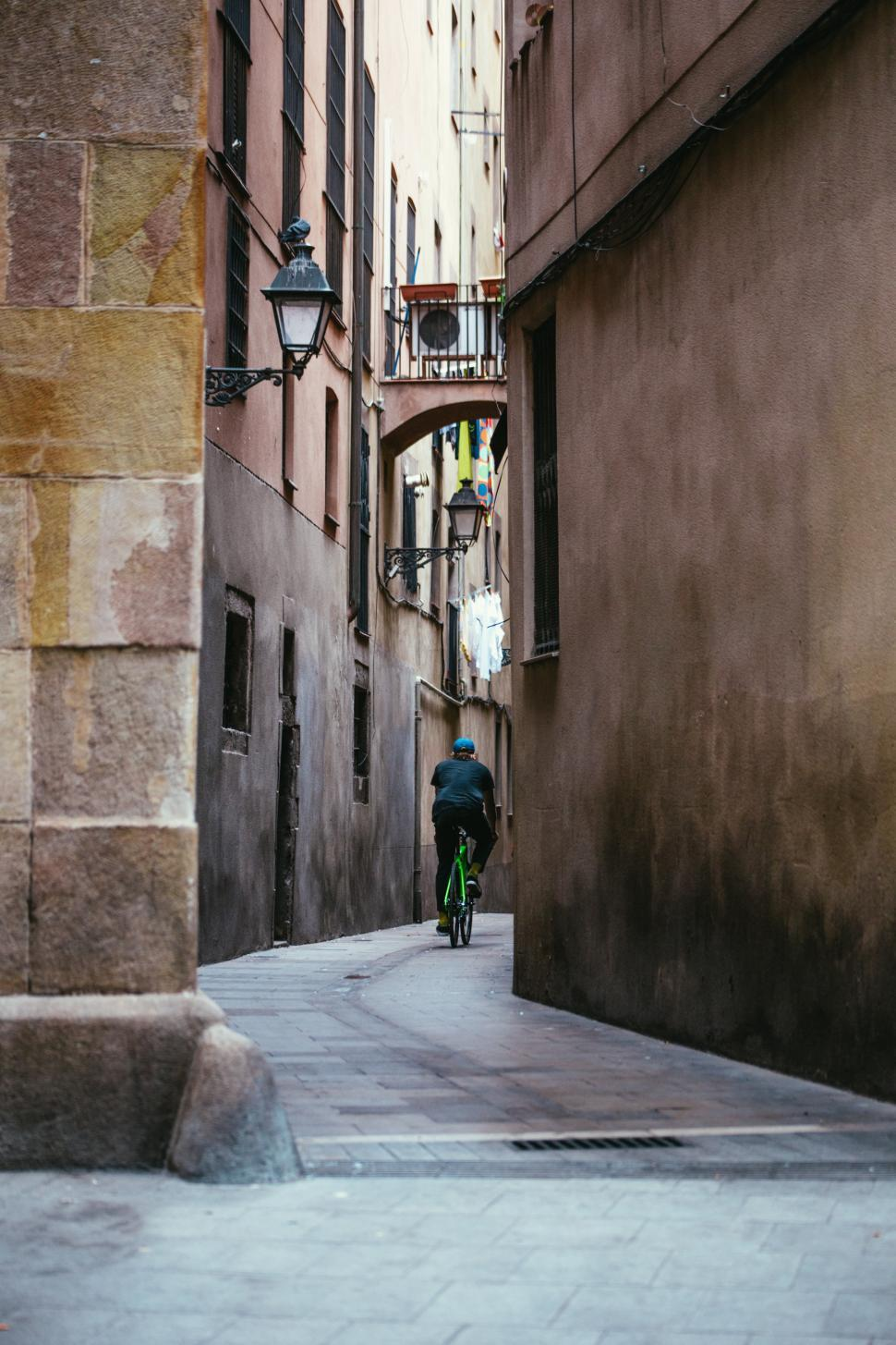 Download Free Stock HD Photo of Cycling down a narrow alley Online