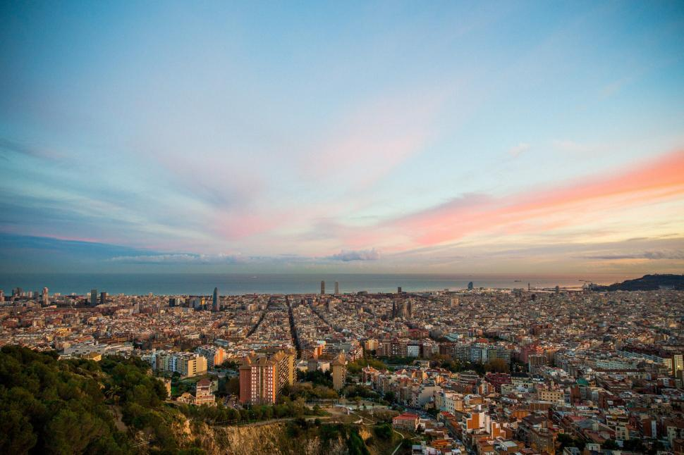 Download Free Stock HD Photo of Barcelona city at sunset Online