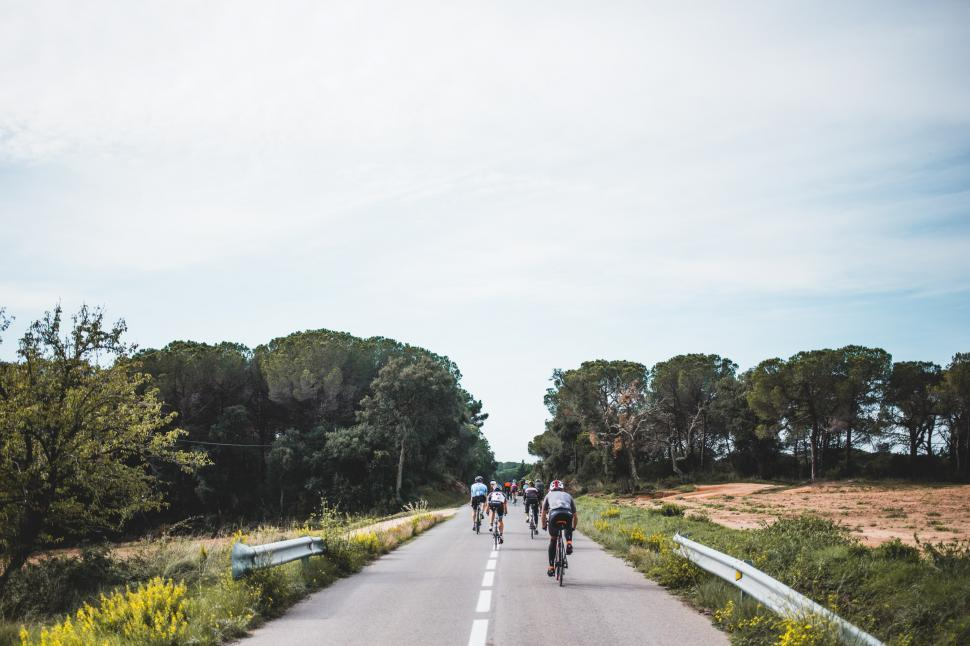 Download Free Stock HD Photo of Cyclists on a country road Online