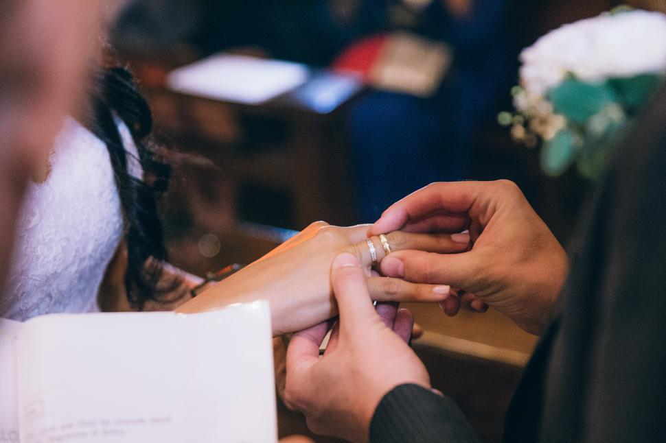 Download Free Stock Photo of Groom putting wedding ring on the bride s finger