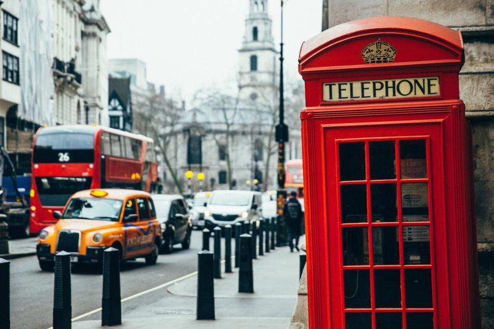 Download Free Stock Photo of British telephone booth on a sidewalk