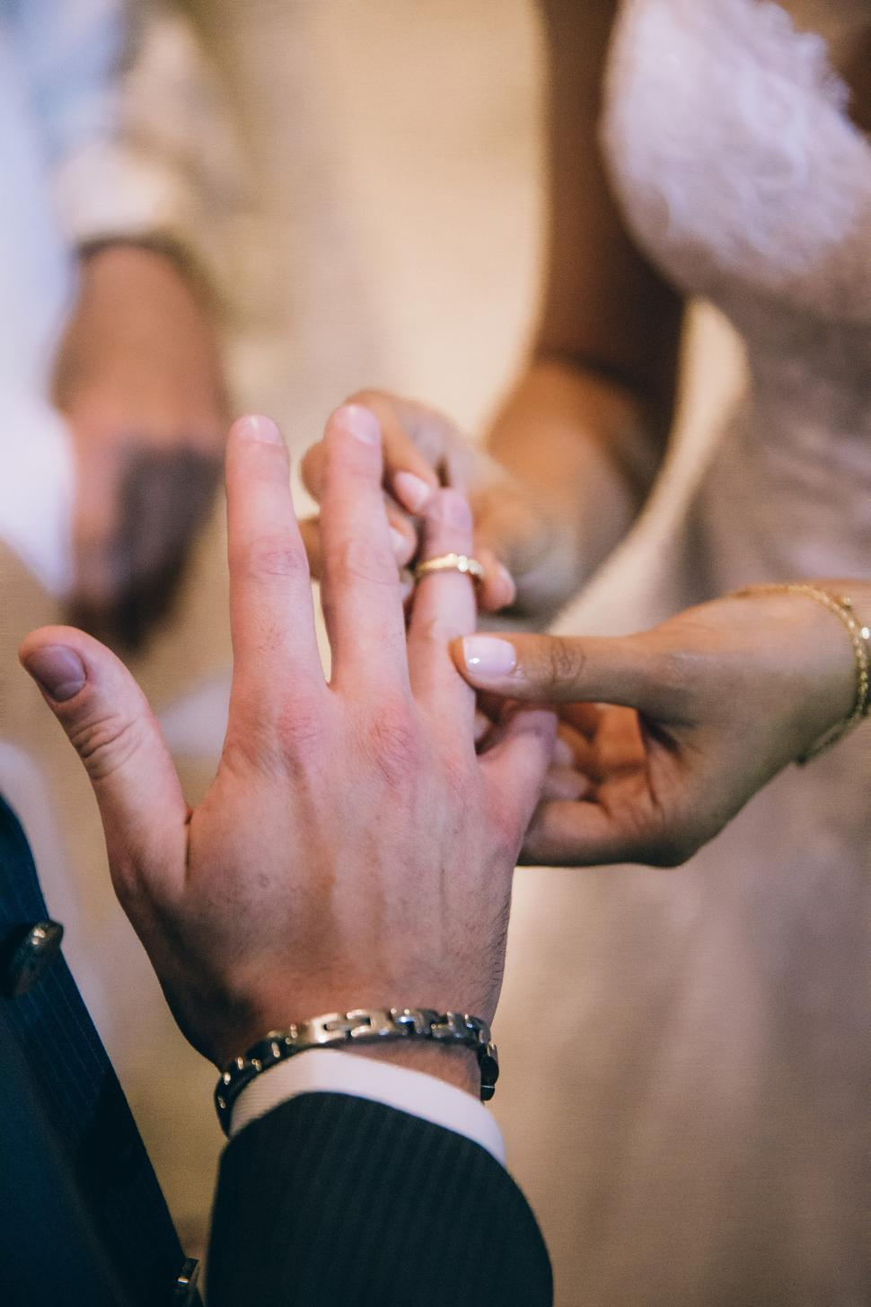 Download Free Stock Photo of Bride putting wedding ring on the groom s finger