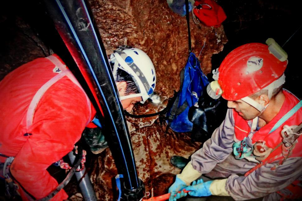 Download Free Stock Photo of Speleology - Cave Explorers Working Inside a Cave - Scientists