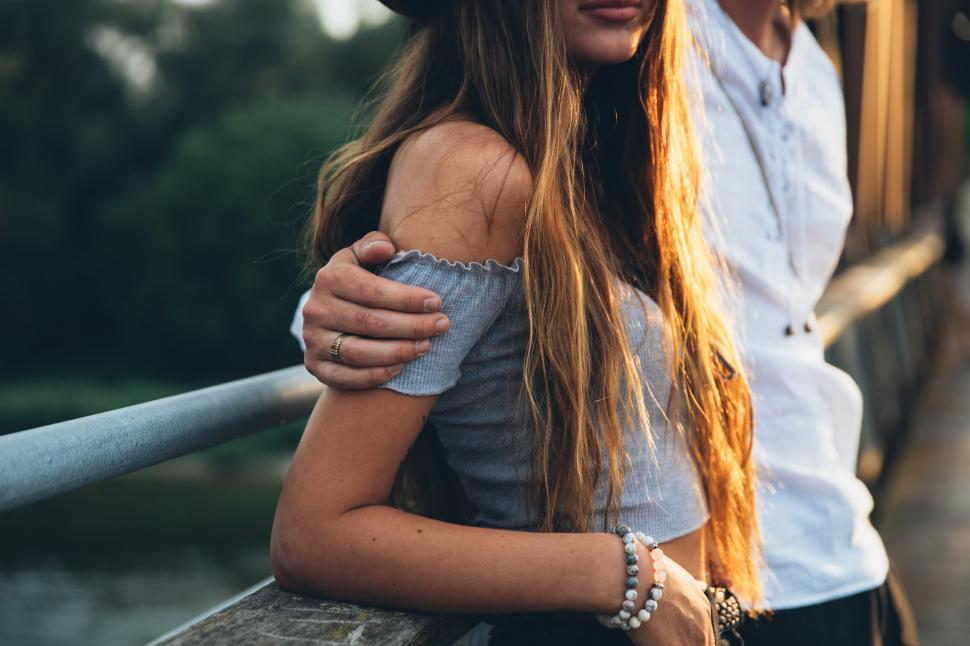Download Free Stock HD Photo of A young caucasian couple at sunset Online