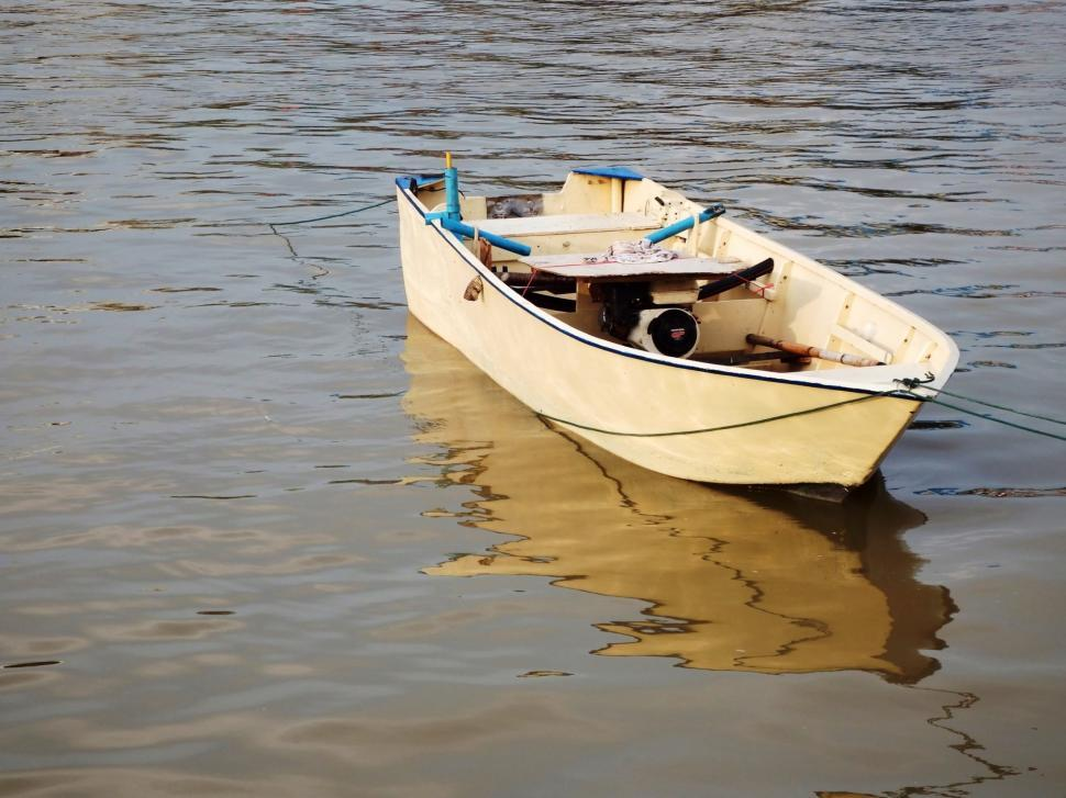 Download Free Stock Photo of Small rowing boat on water