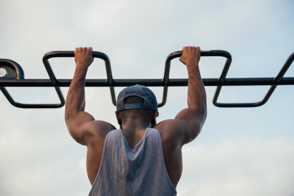 Download Free Stock HD Photo of A young african man doing chin-up exercise Online