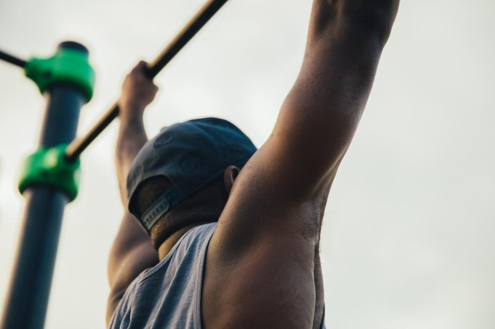 Download Free Stock Photo of A young african man doing chin-up exercise