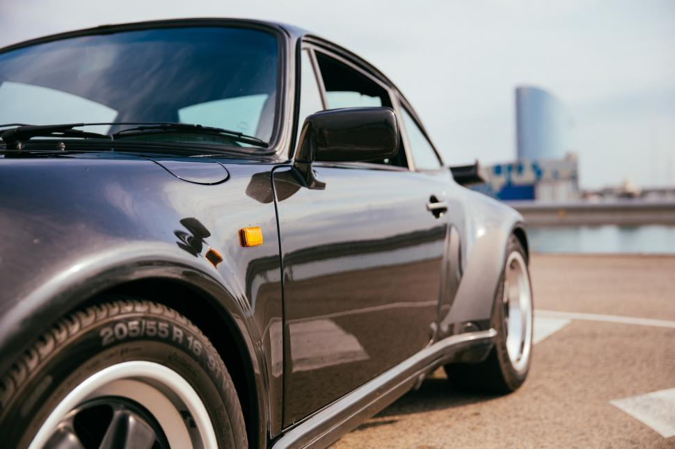 Download Free Stock Photo of Side view of a black sports car