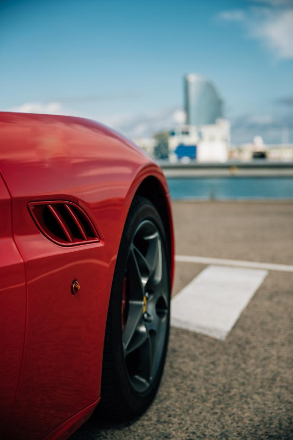 Download Free Stock HD Photo of Side view of a red sports car Online