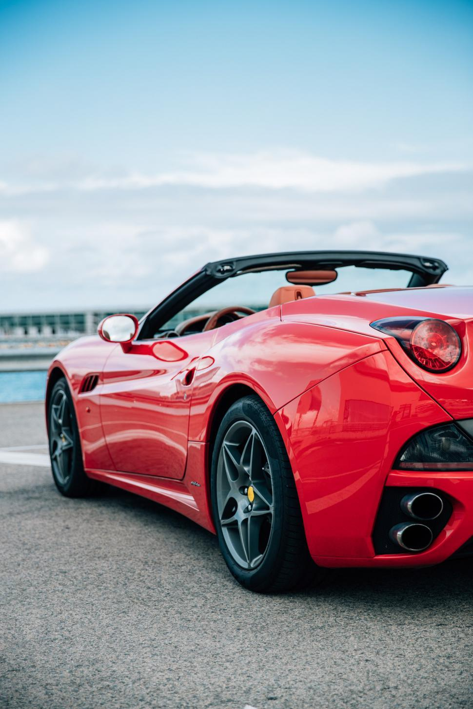 Download Free Stock HD Photo of Side view of a red convertible sports car Online